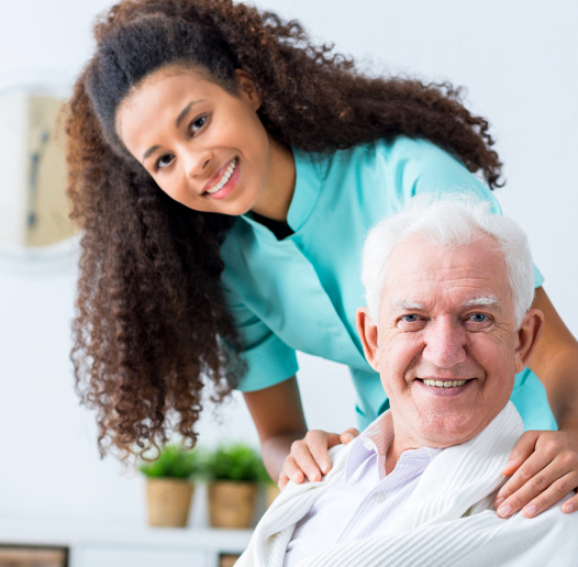 woman caregiver and old man patient